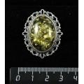 Брошь из янтаря иск., цвет зеленый, с ажурным контуром, цвет ант. серебро, овал 25х18мм