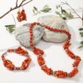 Комплект: серьги, колье, браслет коралл оранжевый галтовка мелкая через бусины