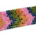 Бусины из кальцита тонированного шарик 10мм, цв.микс 38см, 40 бусин