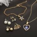 """Гарнитур 6 предмета: 4 пары пуссет, кулон, браслет """"Оберег"""" сердце со звездой, цвет бело-синий, цвет золотистый (пластик, стразы, бижутерны"""