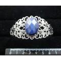 Браслет из лазурита ярко-синего однотонного, овал 25х18мм огранка, жесткая основа, цвет ант.серебро